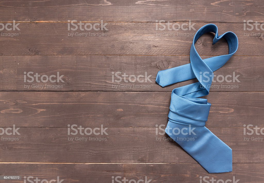 Blue necktie is on the wooden background stock photo