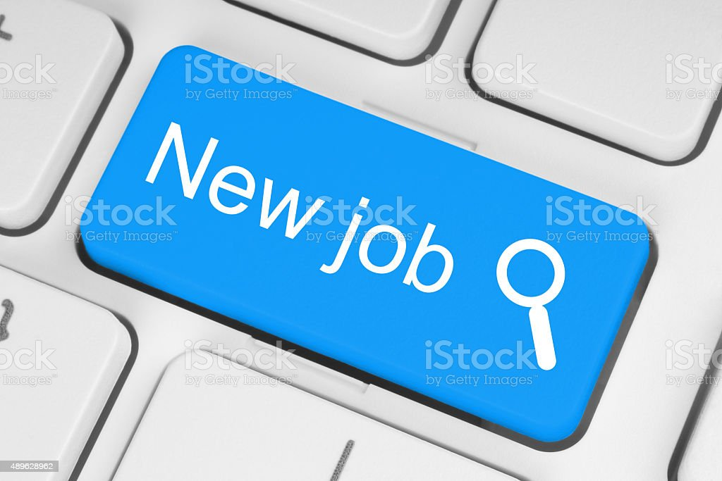 Blue new job button on white keyboard stock photo