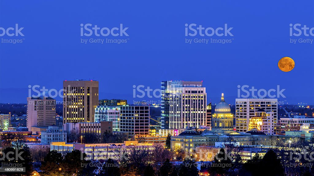 Blue night sky over Boise Idaho with moon stock photo