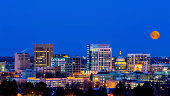 Blue night sky over Boise Idaho with moon