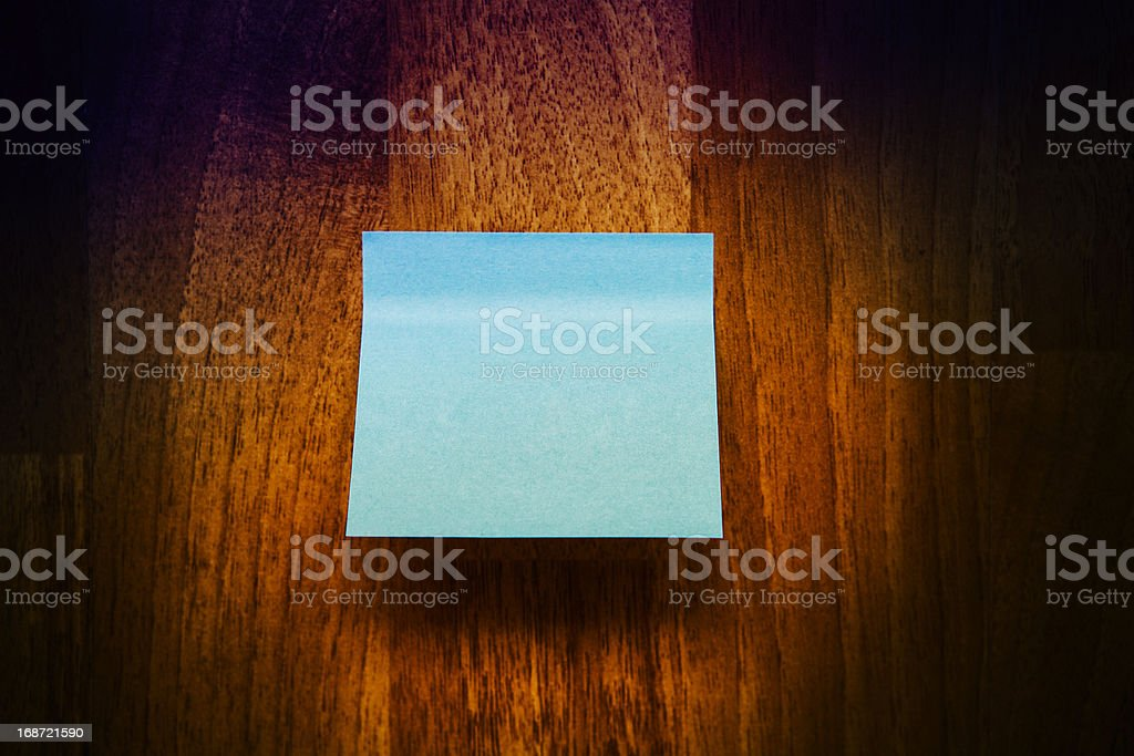 blue note paper on wooden texture royalty-free stock photo
