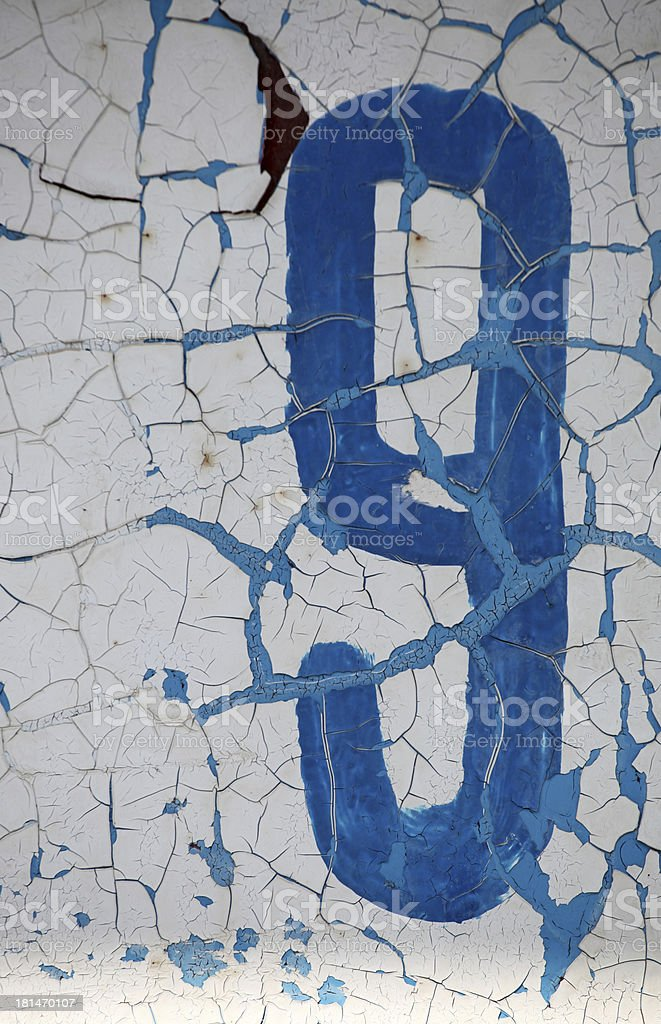 Blue number nine painted on white weather worned background royalty-free stock photo