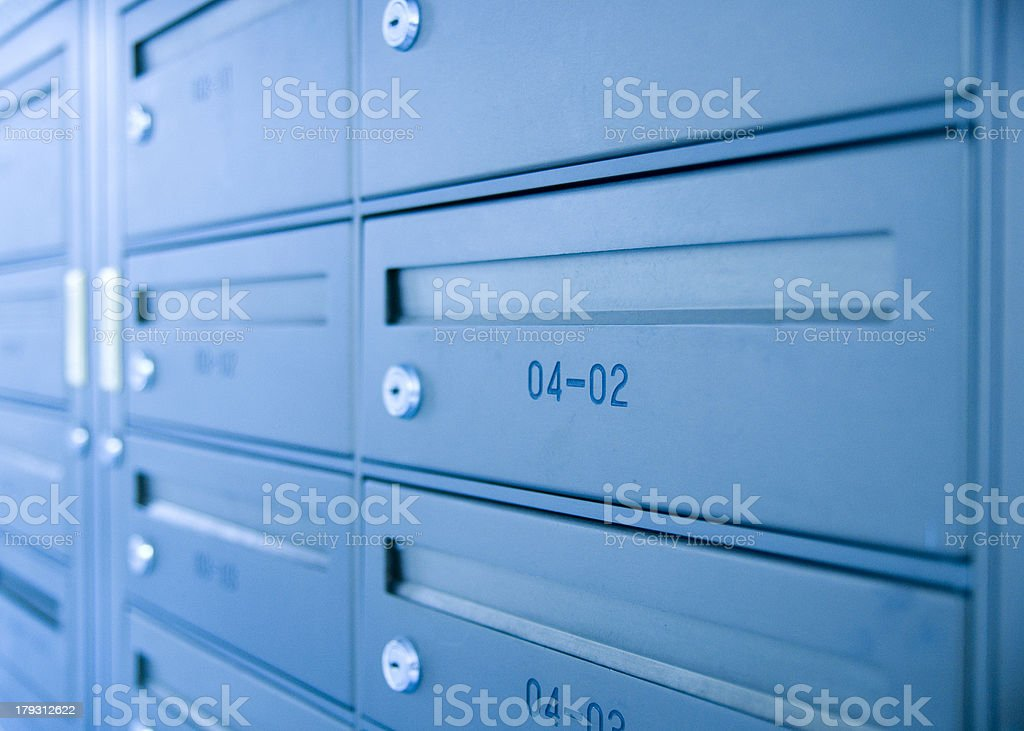 Blue numbered mailboxes with keyholes stock photo