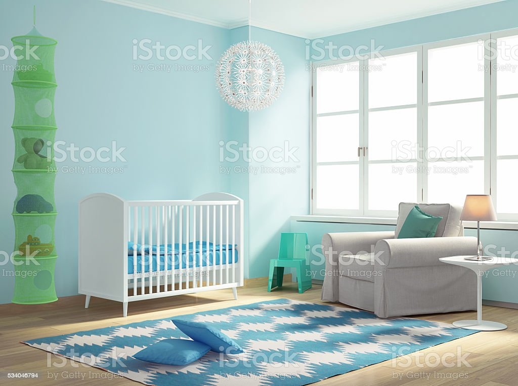 Blue nursery baby room with rug stock photo