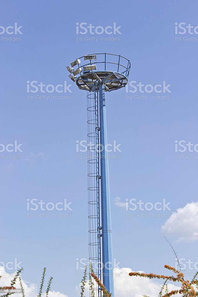Blue observation tower over  sky stock photo