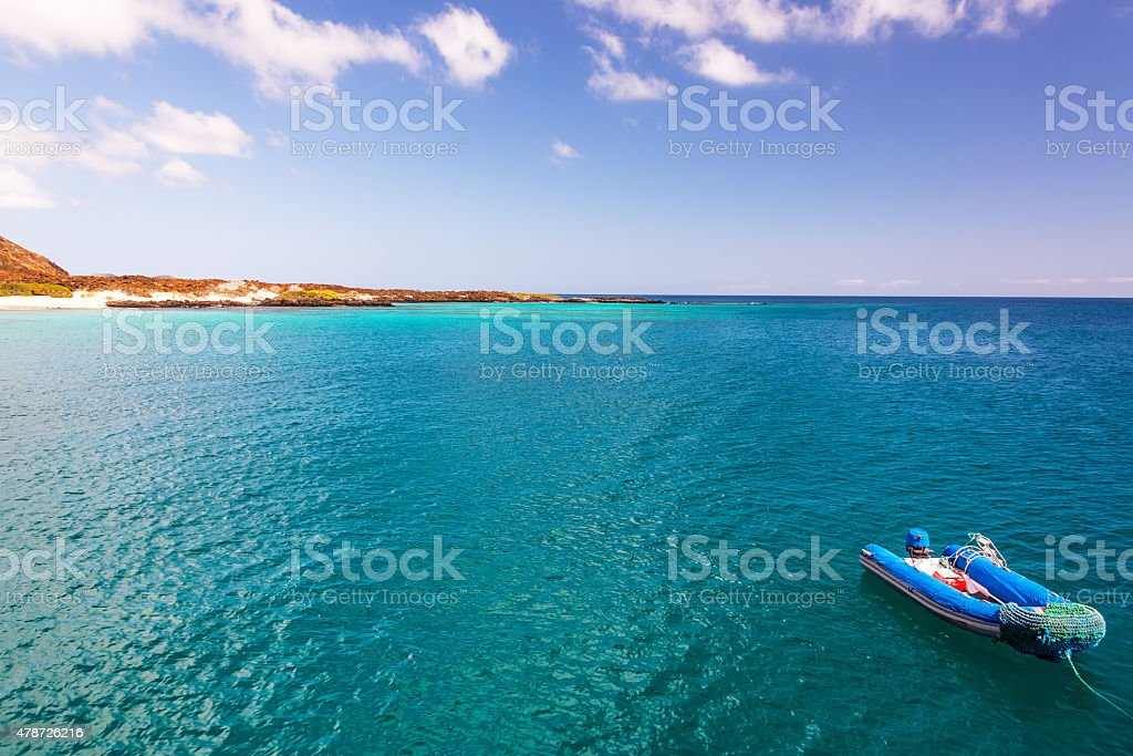 Blue Ocean and Dinghy stock photo