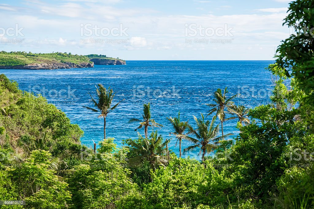Blue ocean and rocks stock photo
