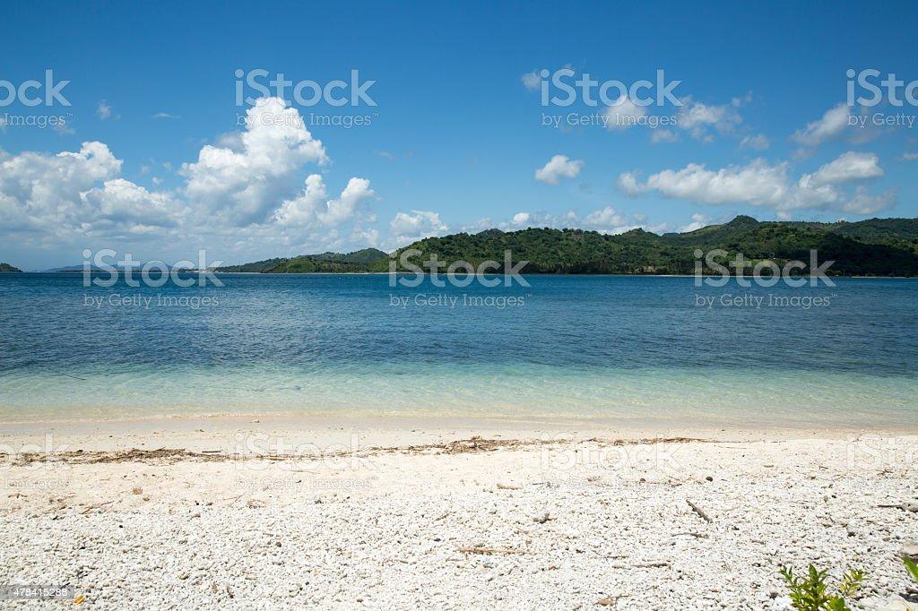 Blue ocean and white sand beach. stock photo