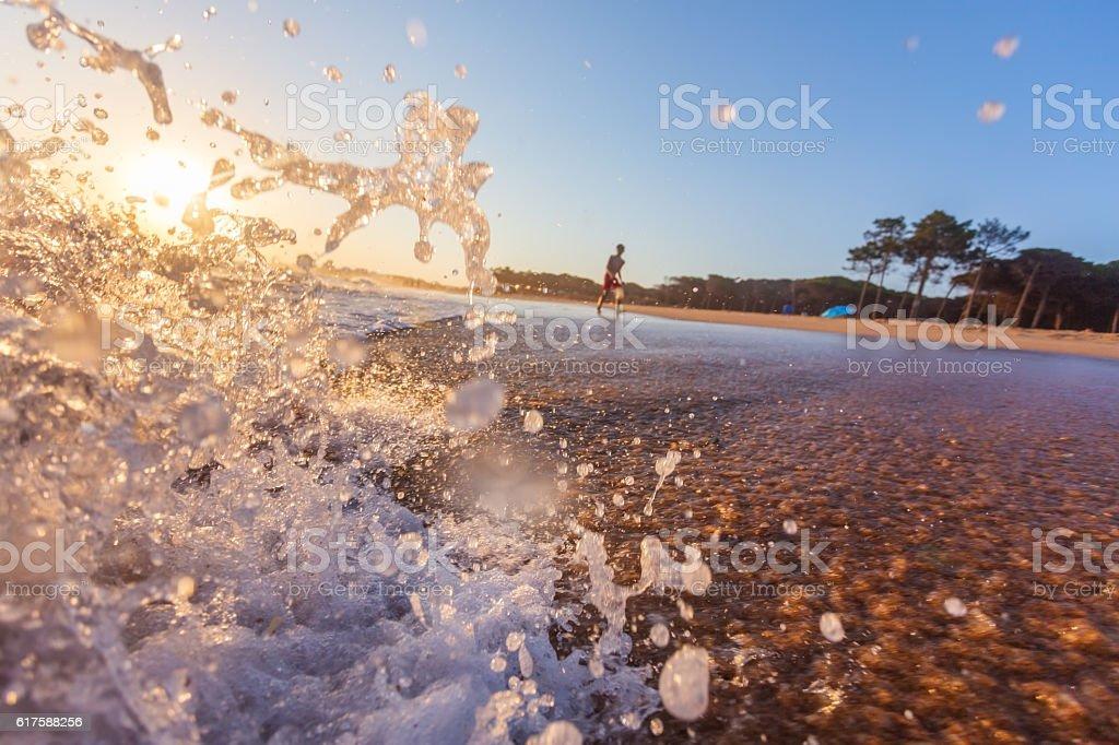 Blue Ocean Wave Crashing at Sunrise stock photo
