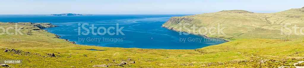Blue ocean yacht in sheltered bay royalty-free stock photo