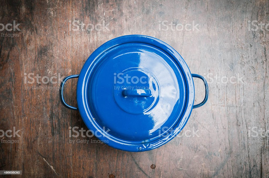 blue of cooking pot on wooden background stock photo