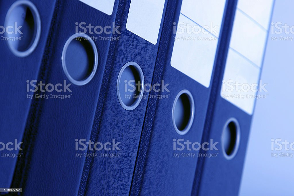 Blue office binders stacked in a row royalty-free stock photo