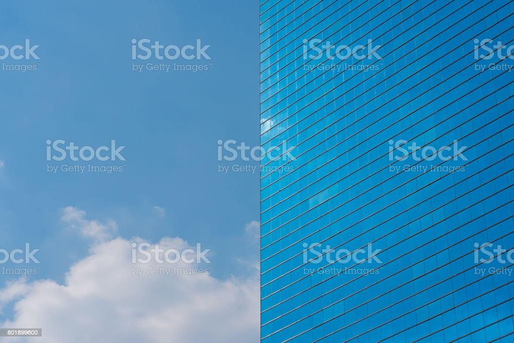 Blue office building background. Skyscraper and blue sky stock photo