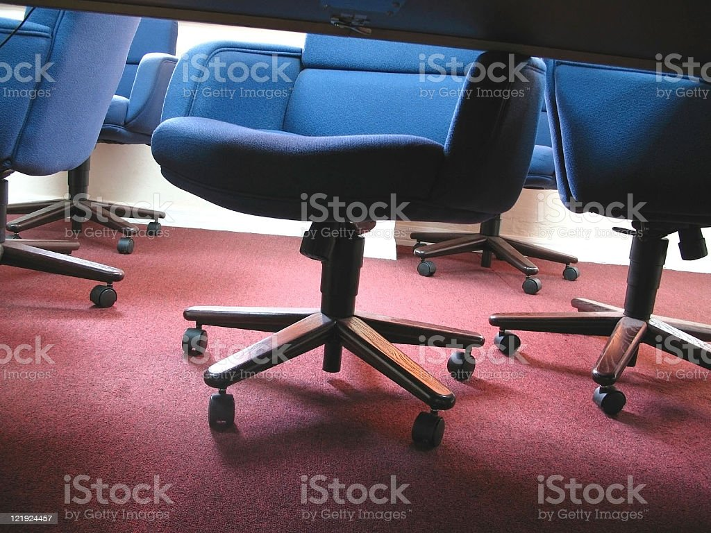 blue office chairs from under the table royalty-free stock photo