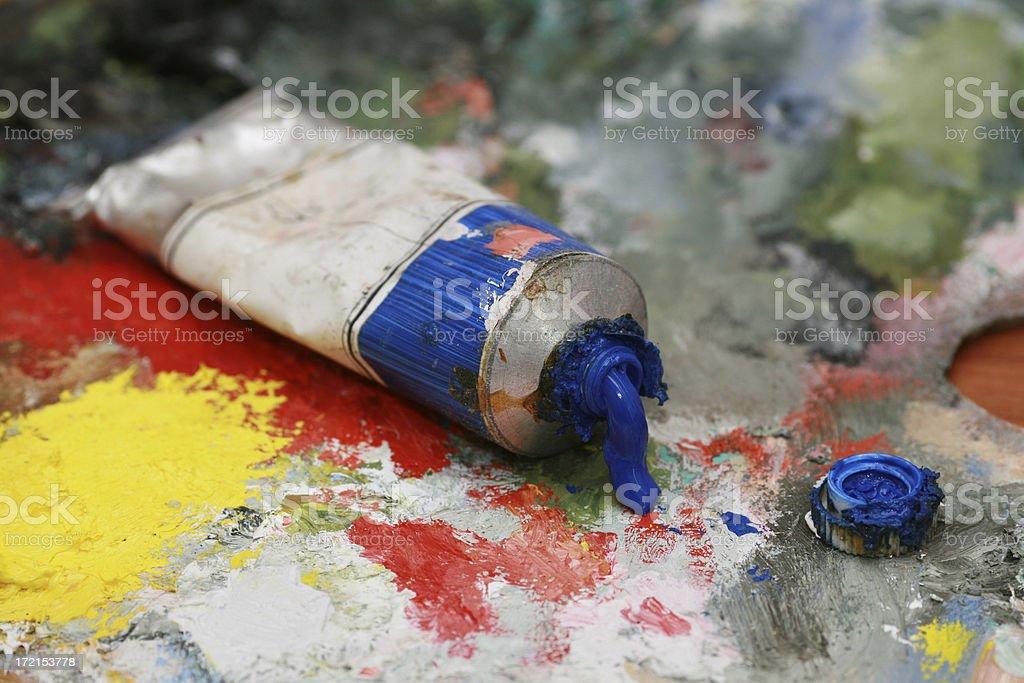 Blue oil color on a palette stock photo