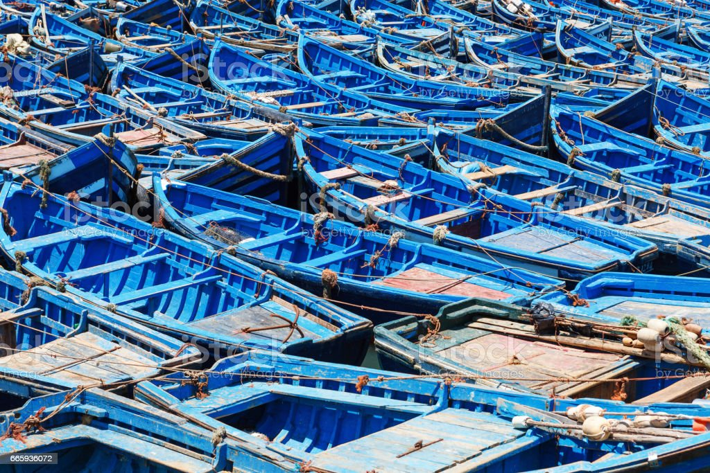 Blue old wooden fishing boats in harbour stock photo