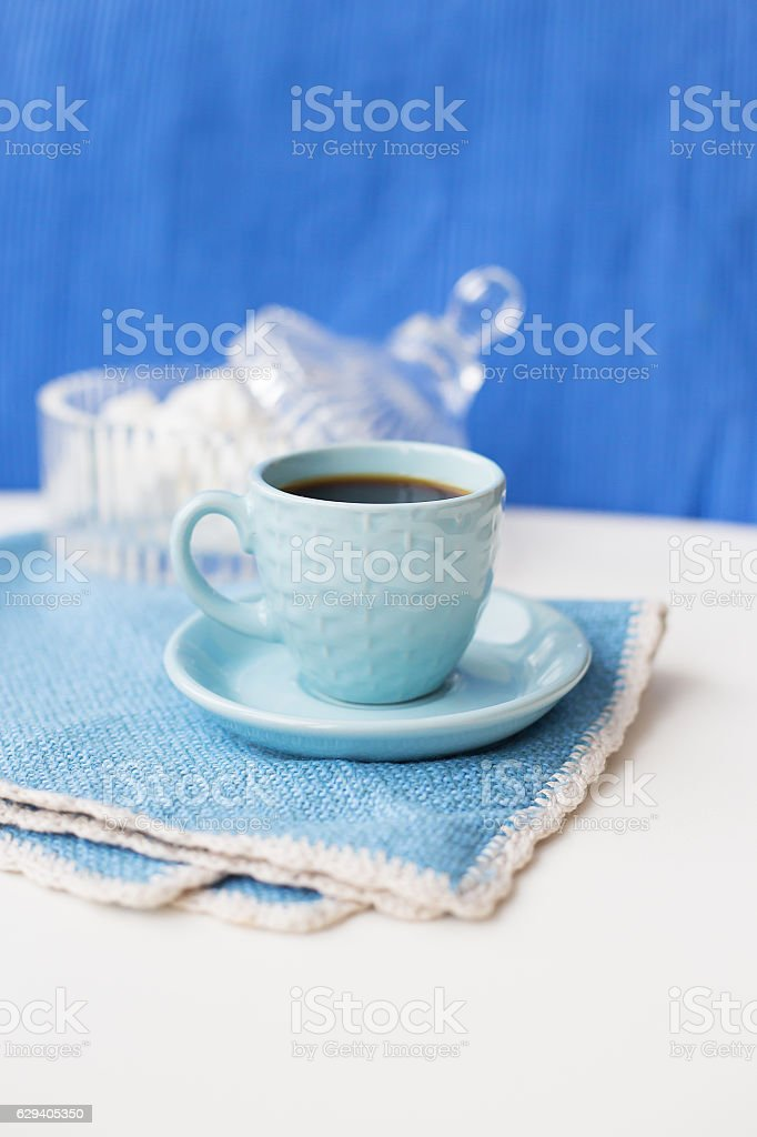 Blue on blue coffee cup and saucer with napkin marshmellou