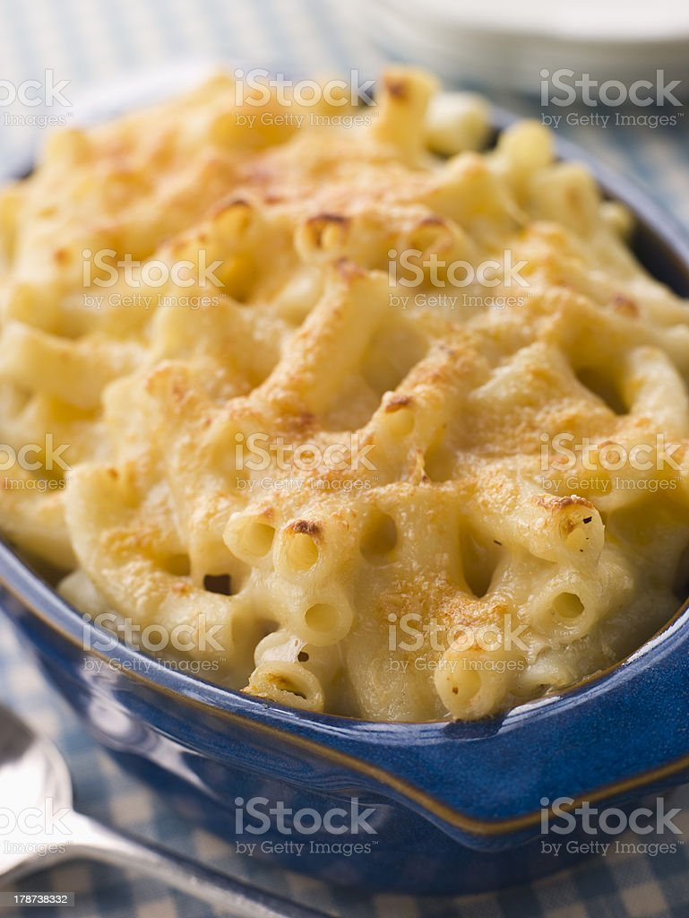 Blue oven proof dish of baked macaroni cheese  royalty-free stock photo