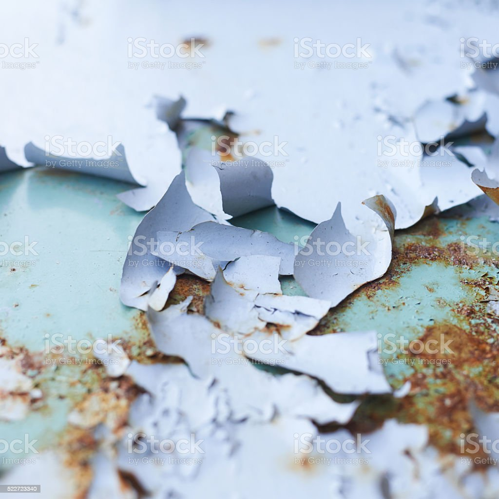 Blue paint flakes falling off stock photo