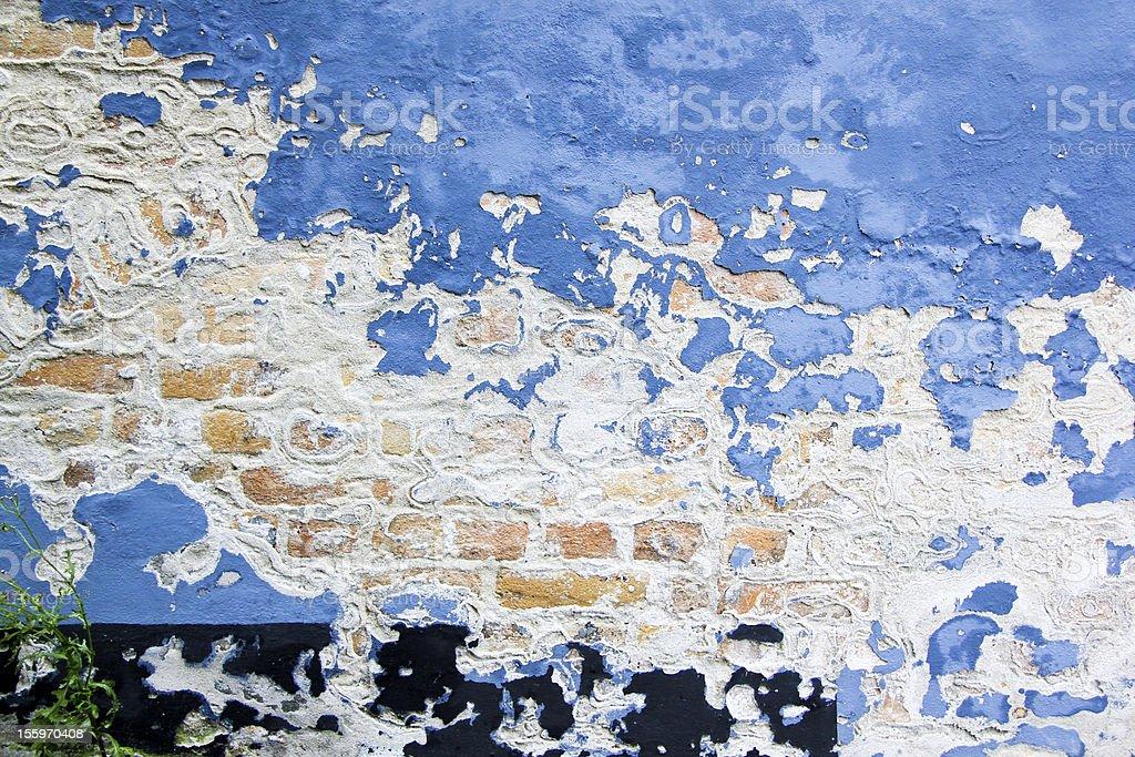 blue paint peeling brick wall background royalty-free stock photo
