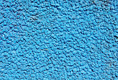 Blue painted  stone mosaic on the wall