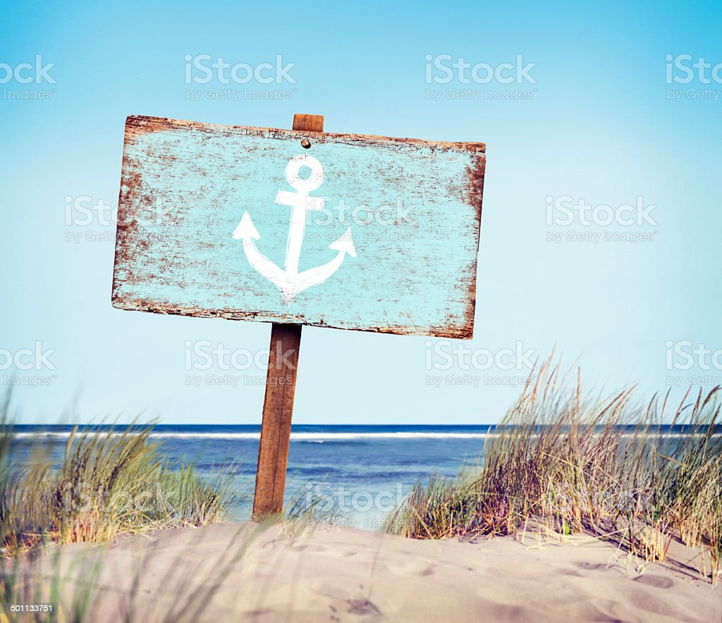 Blue Painted Wood Label on the Beach stock photo