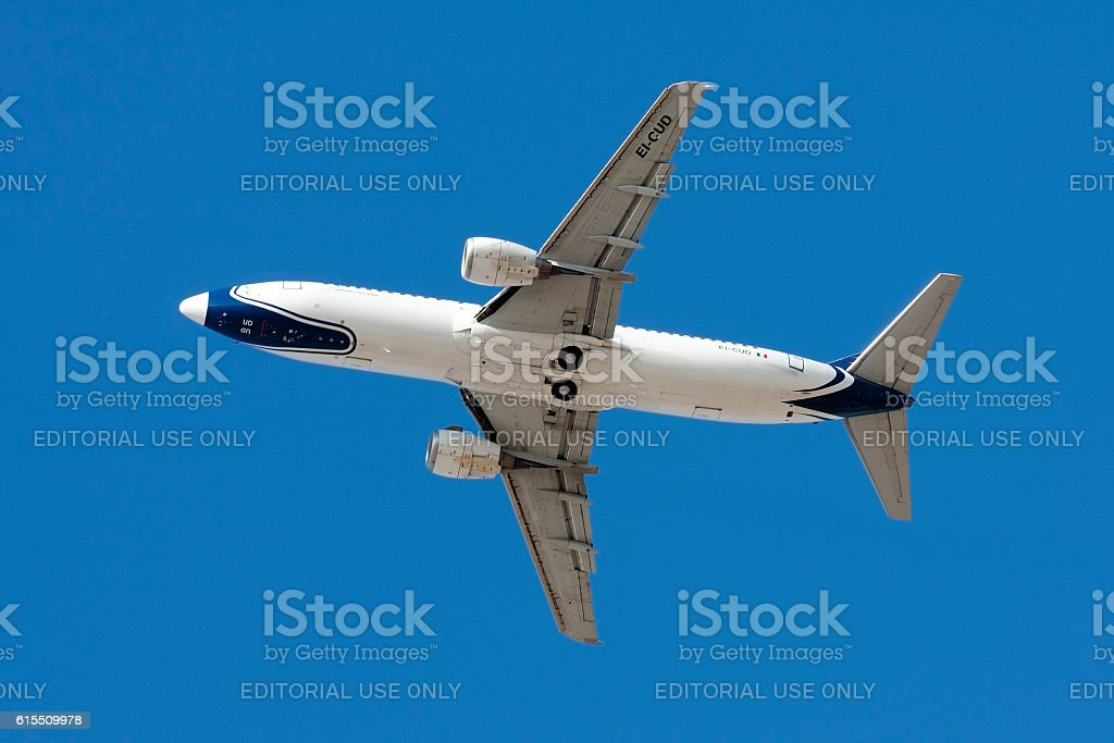 Blue Panorama 737 climbing after take off. stock photo