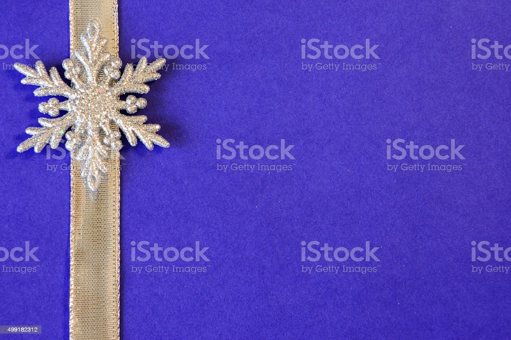 Blue Paper Background with Silver Ribbon and Snowflake Border stock photo
