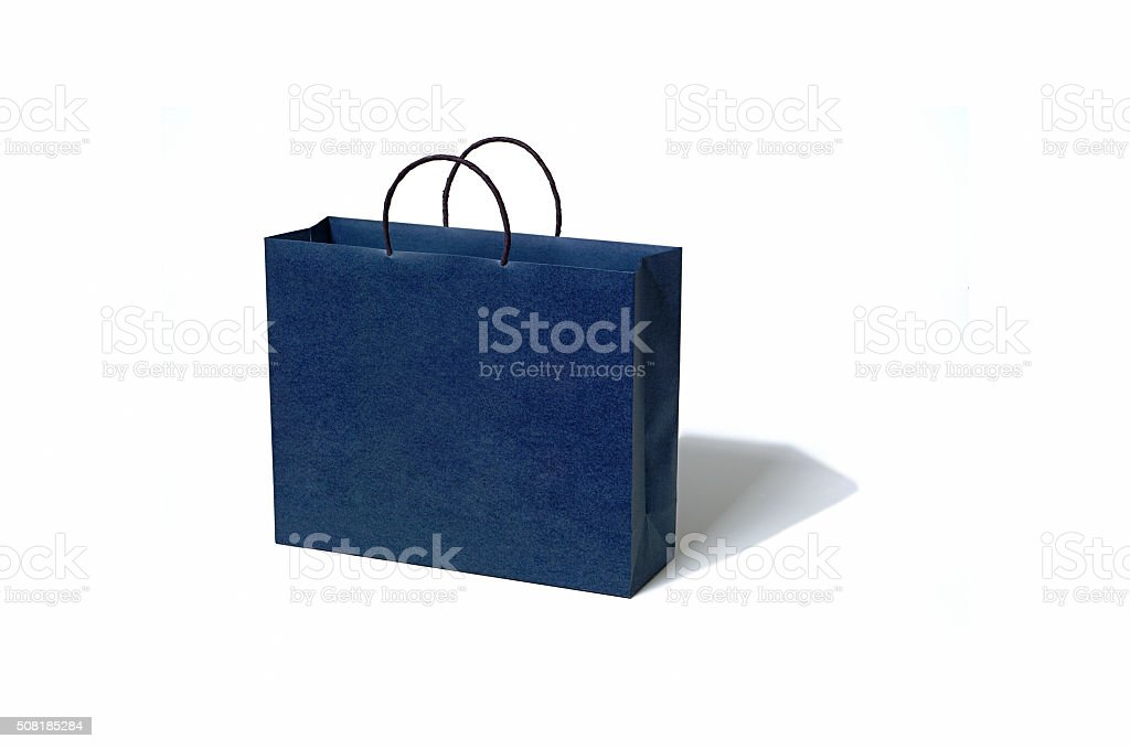 Blue paper bag on white background stock photo