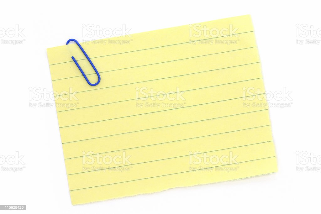 blue paper clip with yellow notepaper royalty-free stock photo