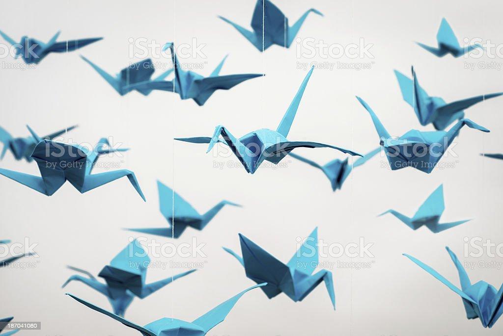Blue paper cranes stock photo