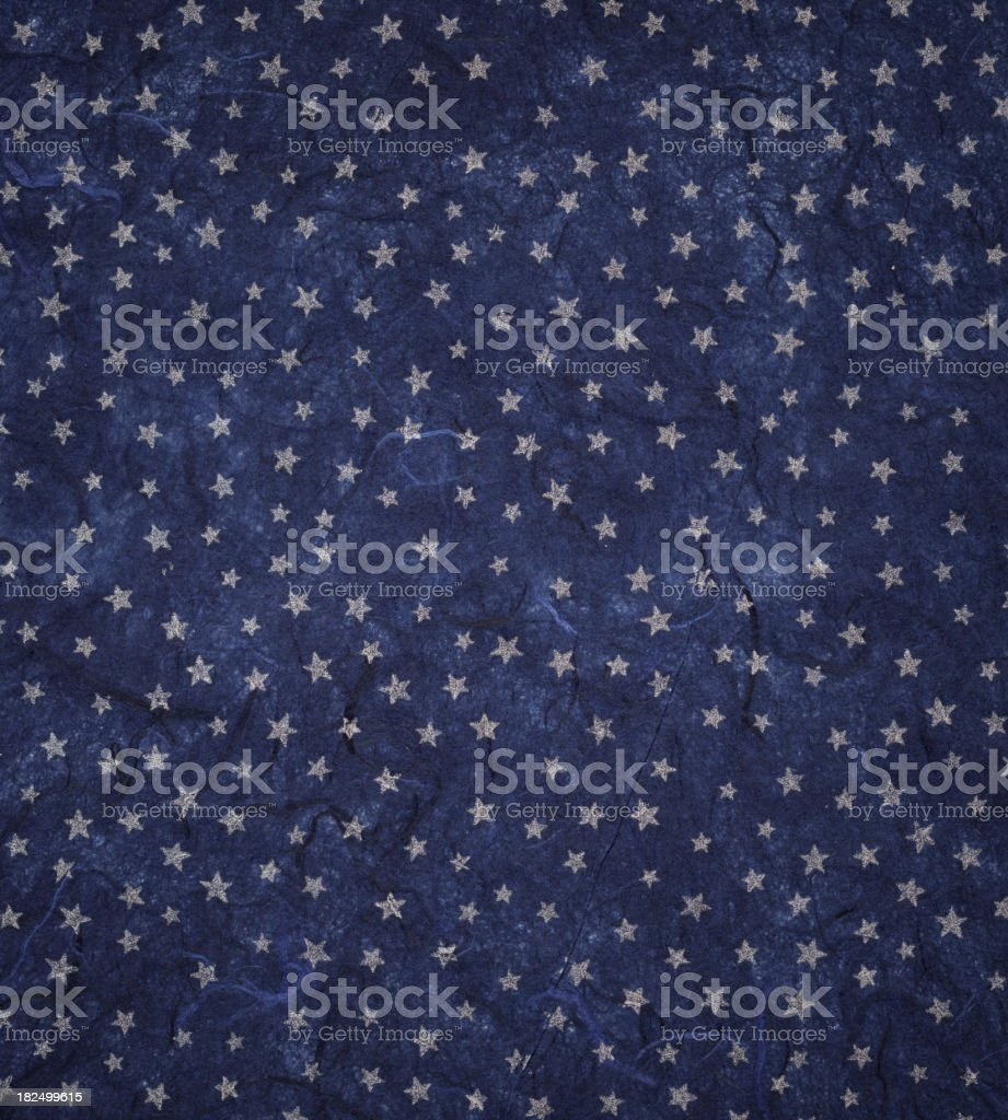 blue paper with silver stars stock photo