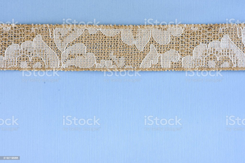 Blue Paper with White Lace and Burlap Border stock photo