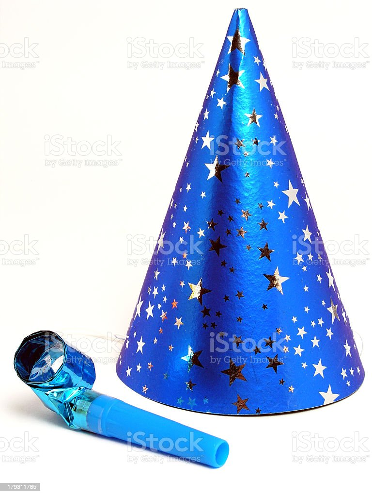 Blue party hat and noisemaker on white background stock photo