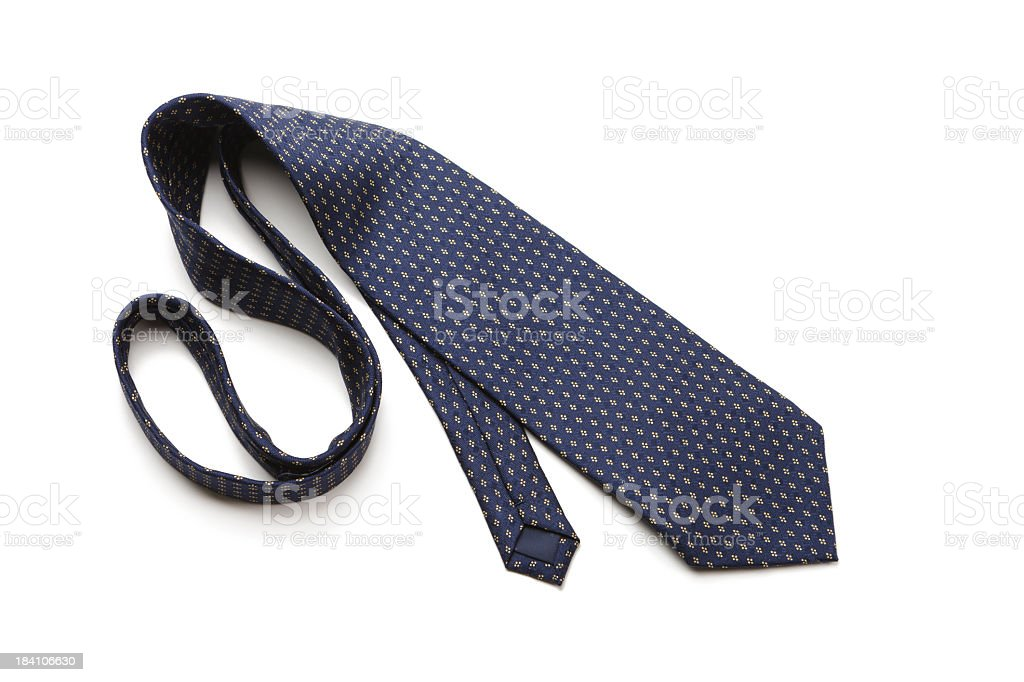 Blue patterned necktie laying on white background royalty-free stock photo