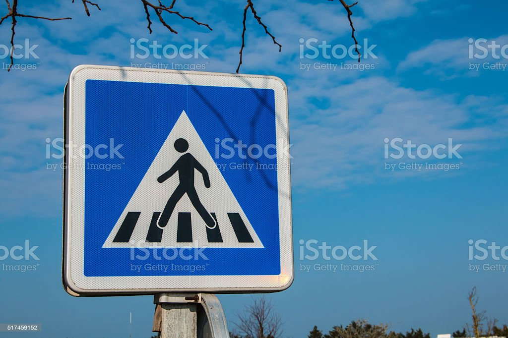 blue pedestrian crossing sign stock photo