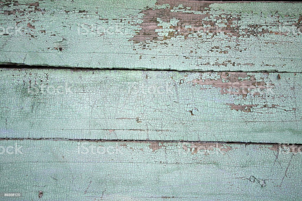 Blue peeling paint on a wooden board royalty-free stock photo