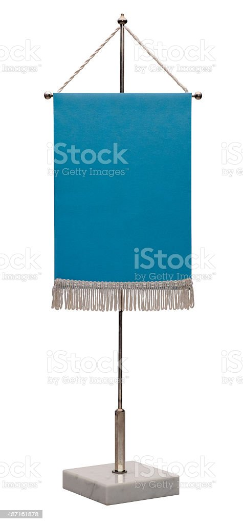 Blue pennant on steel spire on a marble pedestal. stock photo