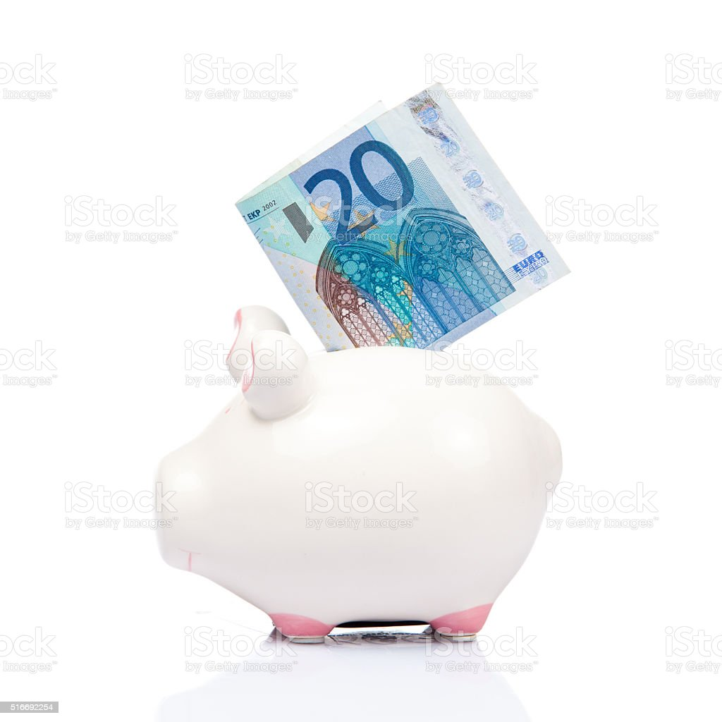 blue Piggy bank with 20 Euro bill. stock photo