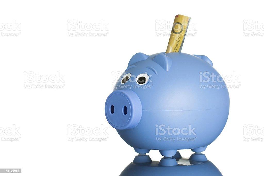 Blue piggy bank with Australian dollars royalty-free stock photo