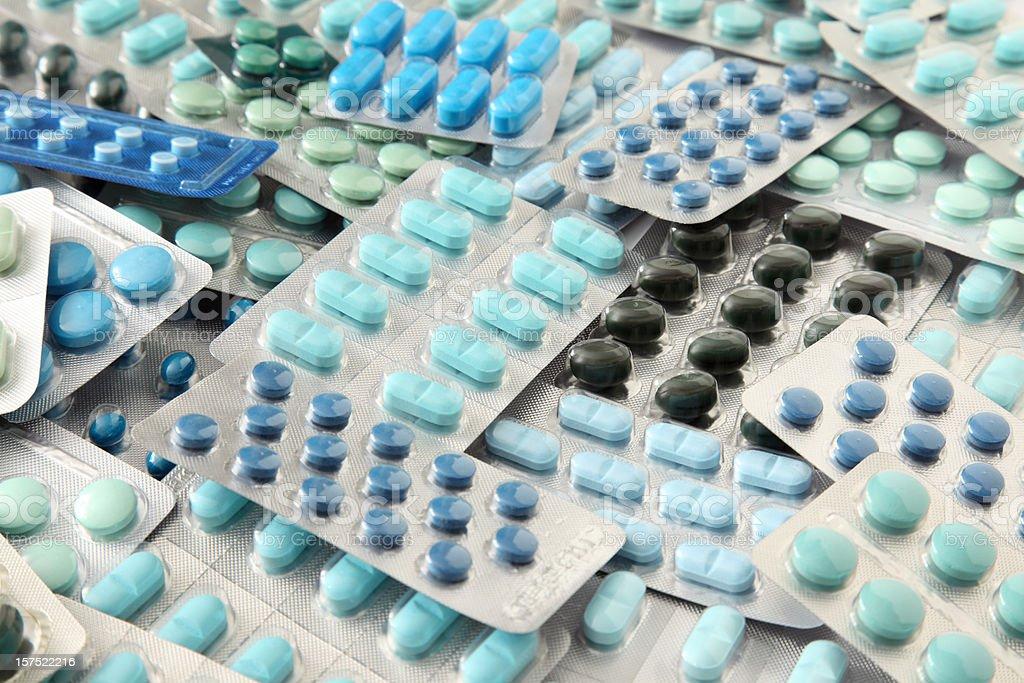 Blue pills in blister packs stock photo