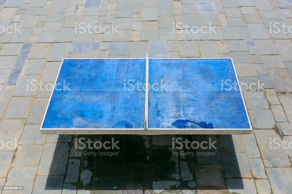 Blue ping pong table sited on the street stock photo