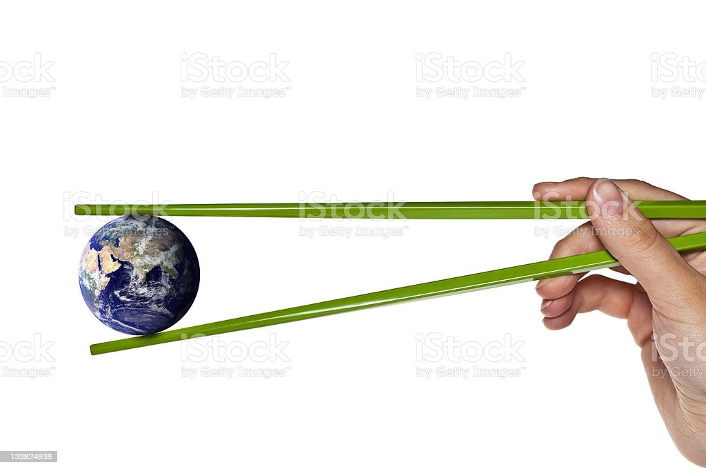 blue planet earth between green chopsticks stock photo