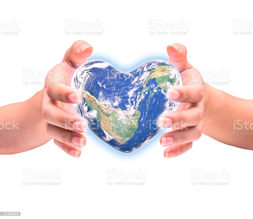 Blue planet in heart shape over woman human hands stock photo