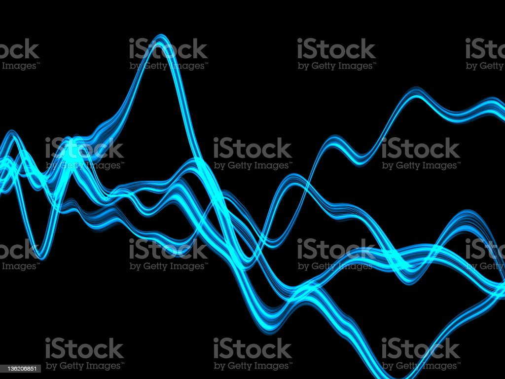 Blue plasma across a dark background stock photo