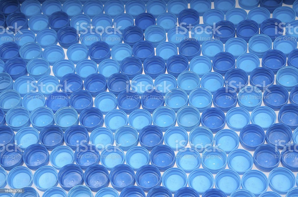 Blue plastic bottle caps royalty-free stock photo