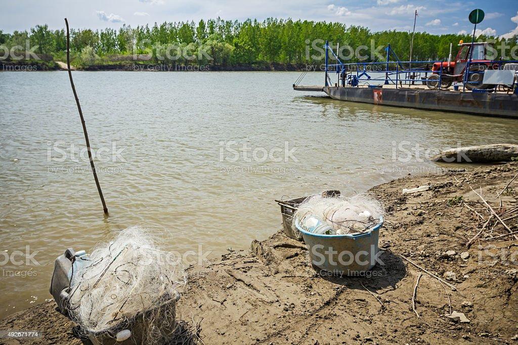 Blue plastic buckets full of fishing nets. stock photo