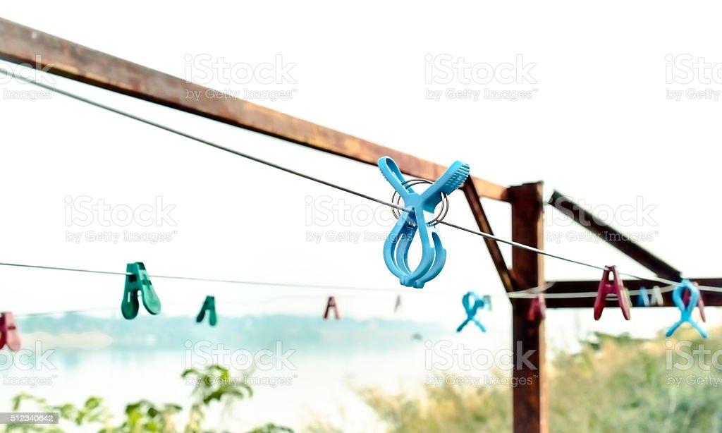 Blue plastic clothespins stock photo