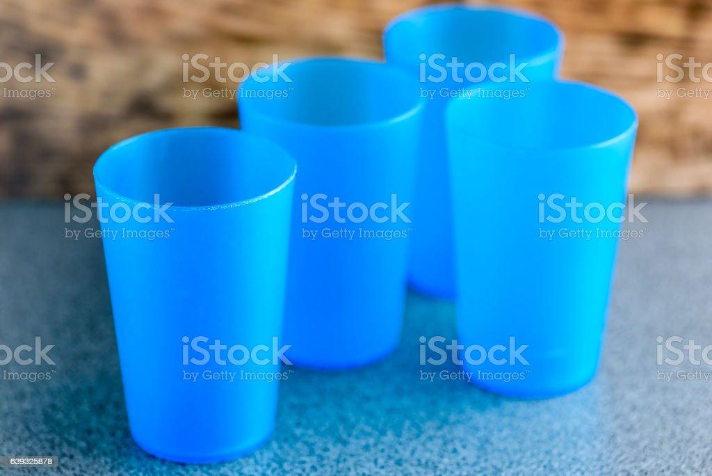 Blue plastic cups stock photo