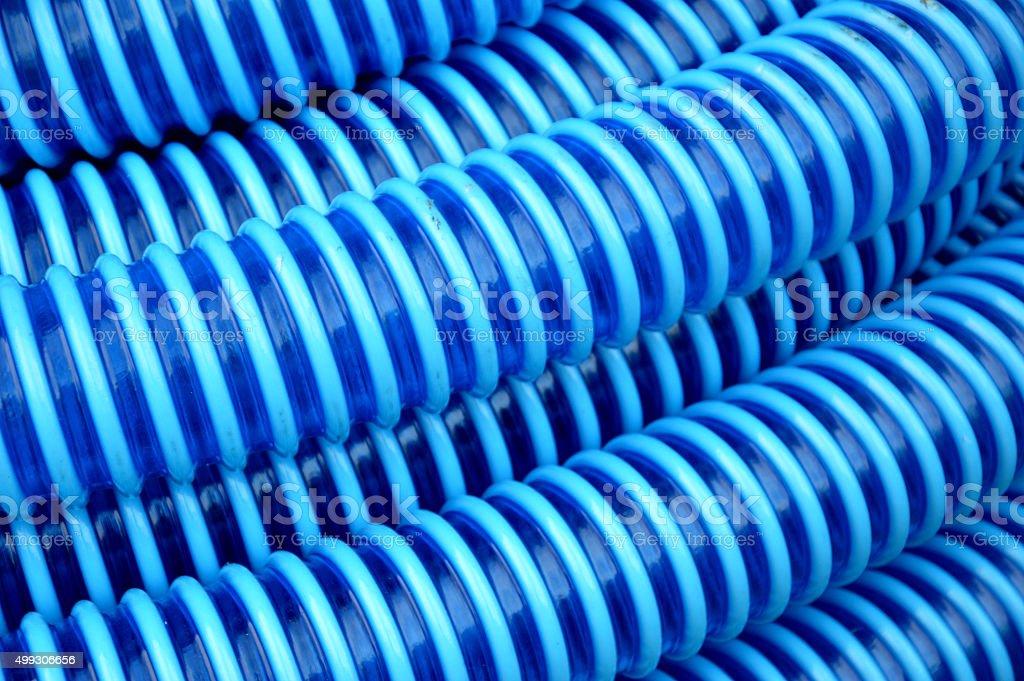 blue plastic hose background stock photo